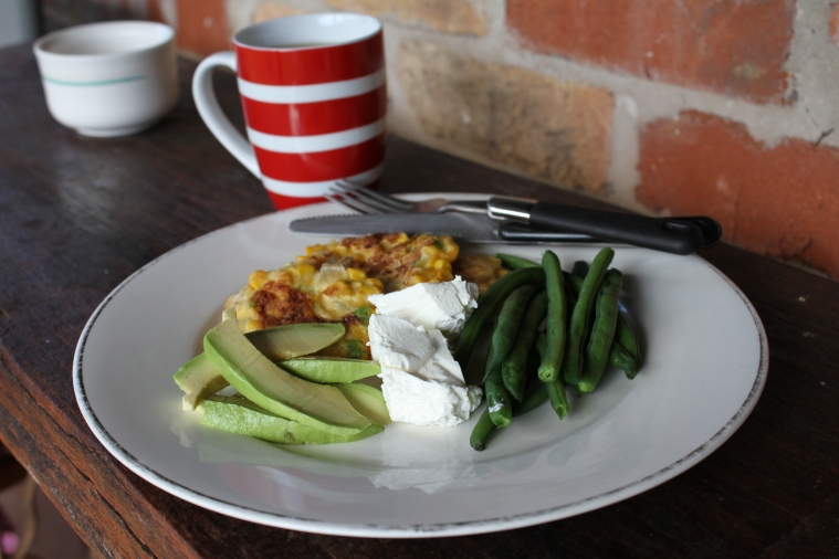 Last breakfast, sweetcorn fritters with avocado, danish feta and green beans, with smokey Lapsang Souchong tea