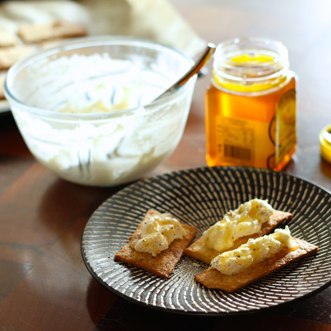 Homemade olive oil crackers with homemade ricotta cheese