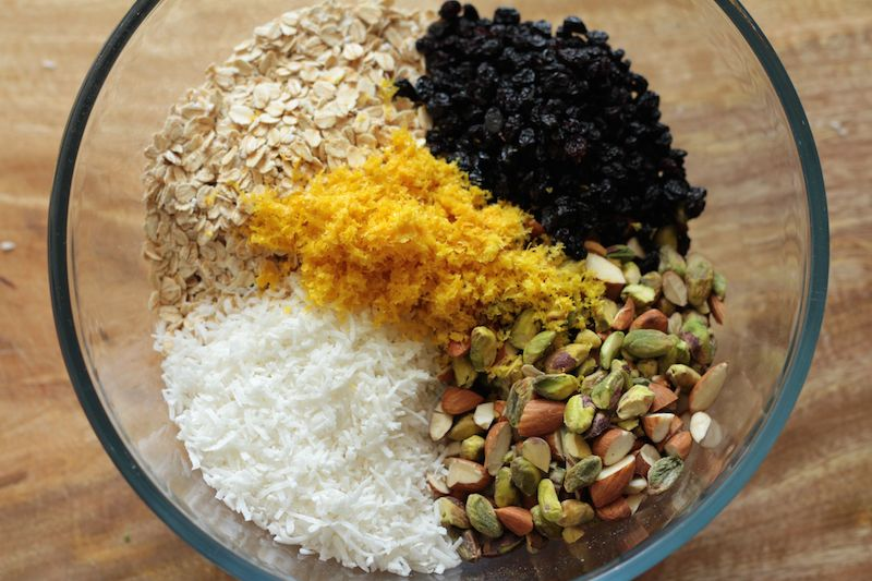 Granola ingredients - oats, coconut, almonds, pistachios, currants and orange zest