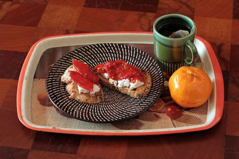 Roasted, marinated capsicums (bell peppers) with toast and feta