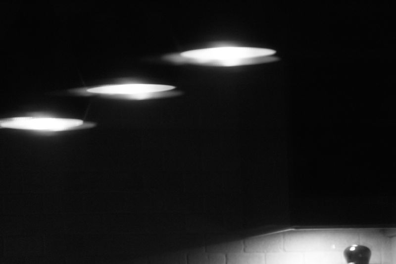 Lamp shades in the kitchen, at night, monochrome