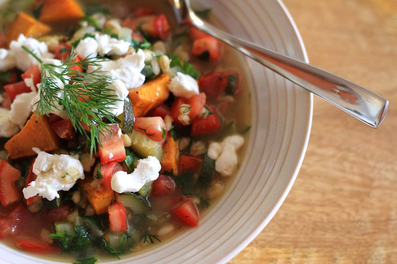 Spring soup - finished with fresh parsley and dill and topped with chèvre