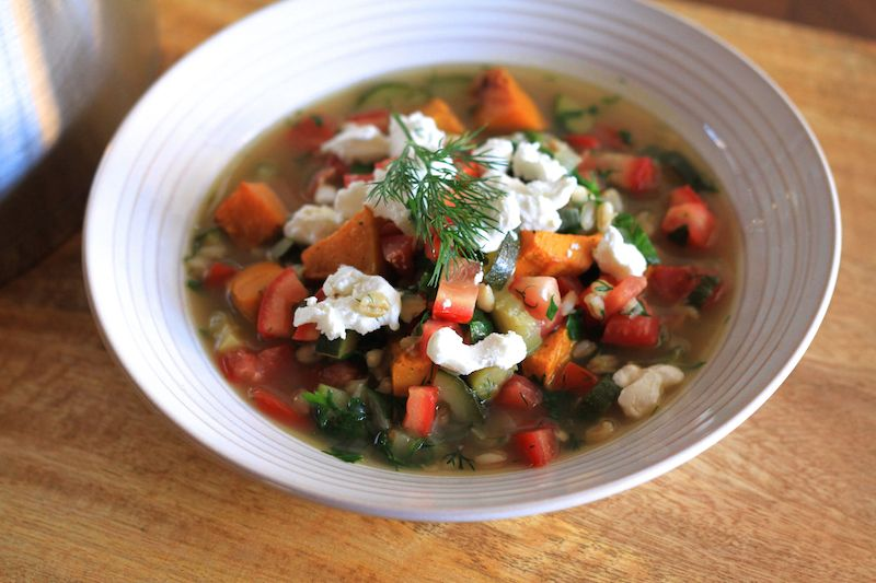 A spring soup, with pearl barley, roasted pumpkin, fresh tomato and herbs
