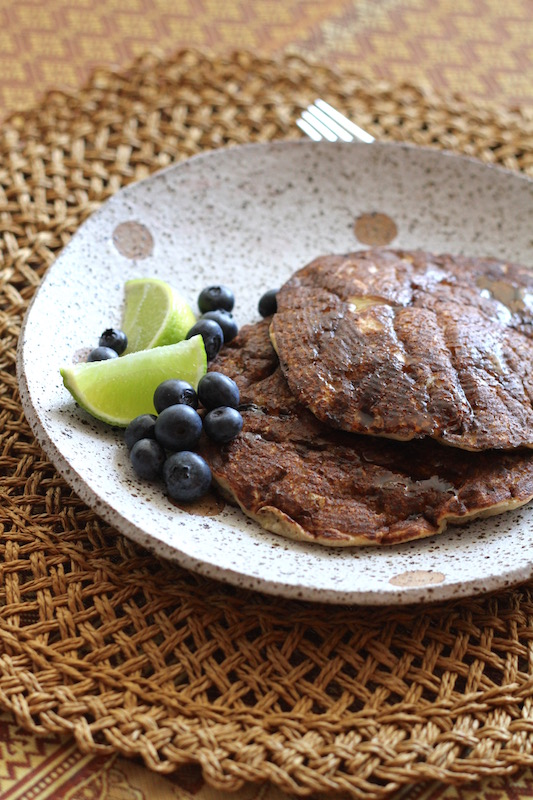 Banana Buckwheat Pancakes with maple syrup, lime and berries