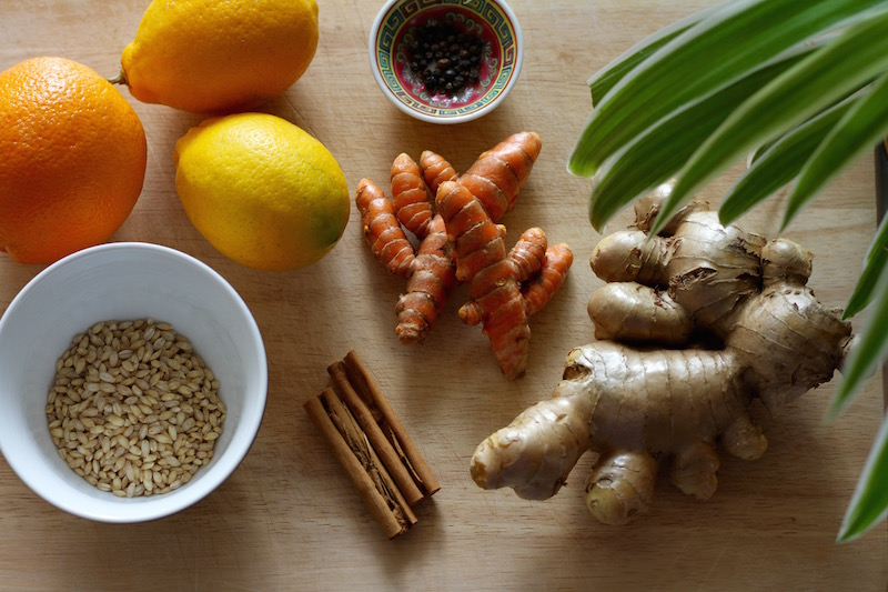 Making Under the Weather Tea - homemade flu remedy with fresh ginger, turmeric and barley