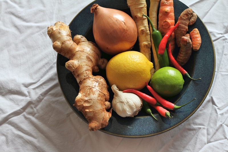 Fresh horseradish, ginger, chilli, turmeric, onions and citrus - ingredients for Fire Cider