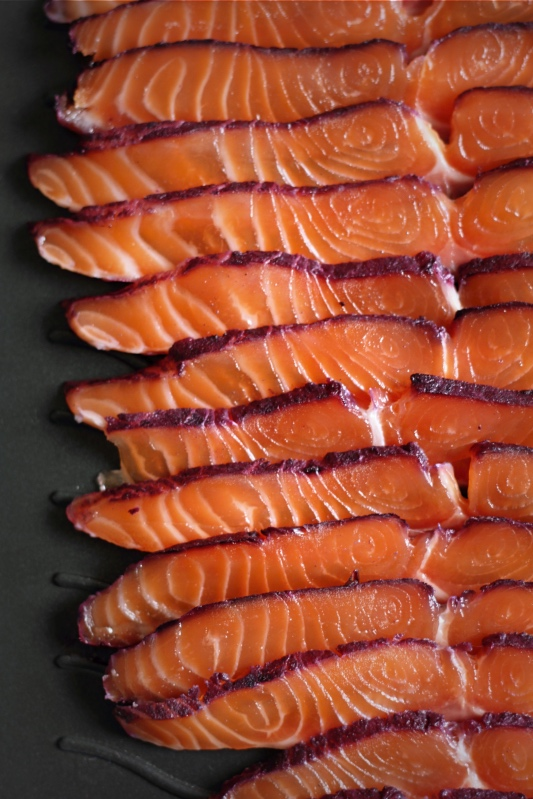 Slices of blackcurrant-cured salmon